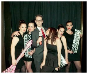 "Just another day in the life of a music video historian: Stephen Pitalo (center) as Robert Palmer with the Addicted to Love ladies at BBQ Films' ""American Psycho"" screening. photo credit: Carly Sioux"