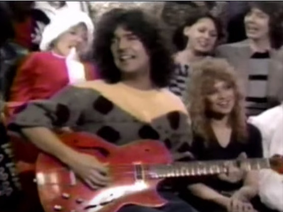 everybody wants you holiday rocker billy squier leads the choir with vj nina blackwood sitting next to him - Billy Squier Christmas Song